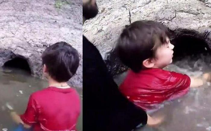 父子湖邊發現一個「神秘洞穴」,伸手進去摸索一番....沒想到拉出的東西讓他心驚肉跳!