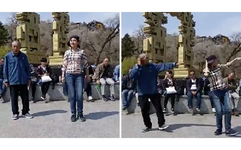 正妹在廣場準備跳舞 但音樂一下大家才驚覺:旁邊阿伯才是主角!